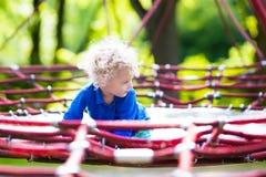 Child having fun on school yard playground Stock Photography
