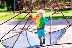 Child having fun on school yard playground Stock Photo