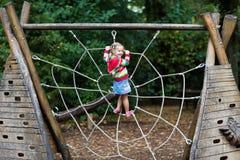 Child having fun on school yard playground Stock Image