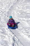 Child having fun on the sled  hill Stock Photos
