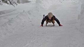 Child having fun on a sleigh on snow stock footage