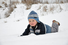 Child having fun on snow Royalty Free Stock Photography