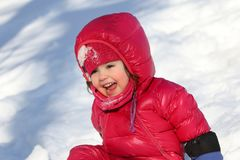 Child playing outdoor during winter Stock Photos