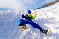 Child having fun at snowy hill. Stock Photo
