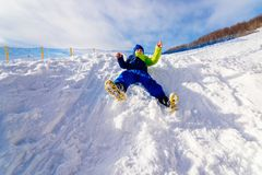 Child having fun at snowy hill. Stock Images