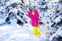 Child having fun in snowy winter park Stock Photography