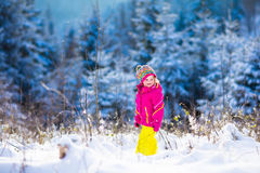 Child having fun in snowy winter park Stock Images