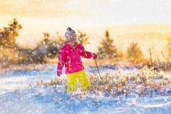 Child having fun in snowy winter park Royalty Free Stock Photo