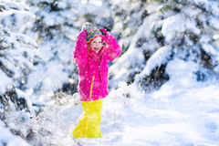 Child having fun in snowy winter park Royalty Free Stock Images
