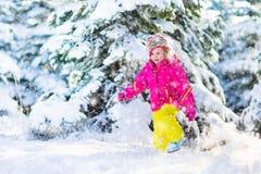 Child having fun in snowy winter park Stock Image