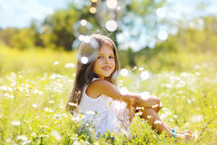 Child having fun in summer day. With soap bubbles Stock Photos