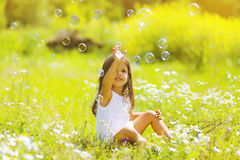 Child having fun in summer day. Soap bubbles Stock Image