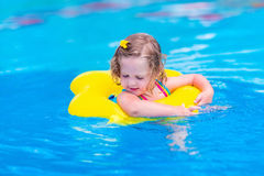 Child having fun in a swimming pool Stock Images