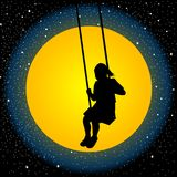 Child having fun on a swing in the night. With moon and stars Royalty Free Stock Photos