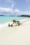 Child having Fun on Tropical Beach near Ocean Royalty Free Stock Image
