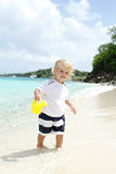 Child having Fun on Tropical Beach near Ocean Stock Photography