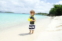 Child having Fun on Tropical Beach near Ocean Royalty Free Stock Images