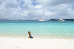 Child having Fun on Tropical Beach near Ocean Stock Photo