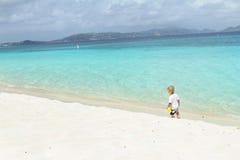 Child having Fun on Tropical Beach near Ocean Royalty Free Stock Photos