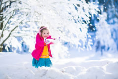 Child having fun in winter snowy park Stock Image