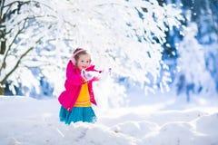 Child having fun in winter snowy park Stock Image