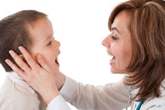 Child having physical exam at the doctor Stock Images