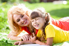 Child having picnic and reading book in summer Royalty Free Stock Images