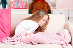 Child having stomach ache. Little girl suffering from stomach ache Royalty Free Stock Images