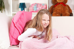 Child having stomach ache. Child suffering from stomach ache royalty free stock images