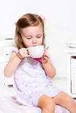 Child having tea Royalty Free Stock Image
