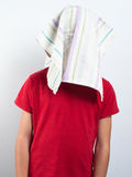 Child with head hidden from duster Stock Image
