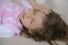 Child with headache Royalty Free Stock Photo