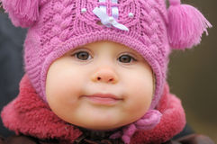 Child in heading. Portrait of child in pink heading Stock Images