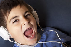 Child with headphone Stock Images