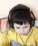 Child with headphones stock photo