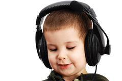 The child in headphones Stock Images