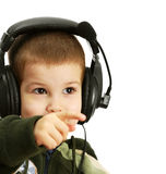 The child in headphones. On a white background Royalty Free Stock Image