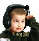 The child in headphones. On a white background Royalty Free Stock Photo