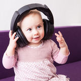 Child with headphones Royalty Free Stock Image