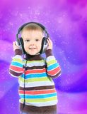 Child in headphones, color background Stock Images
