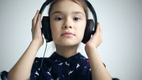 Child with headphones dancing at studio background. Model Elizabeth Andreeva stock video