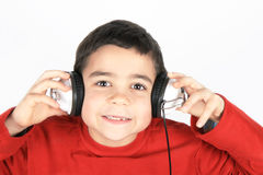 Child  with headphones. Happy and smilling child with headphones Stock Image