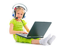 Child in headphones with laptop Stock Image
