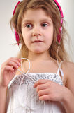 Child with headphones listening to music Stock Images