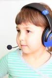 Child in headphones Stock Photography