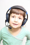 Child in headphones Royalty Free Stock Photos