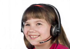 The child in the headset. Royalty Free Stock Images
