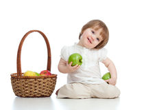 Child with healthy food apples Stock Images