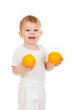 Child with healthy food oranges fruits Royalty Free Stock Image