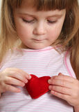 Child and heart. Pretty child with red heart Royalty Free Stock Image